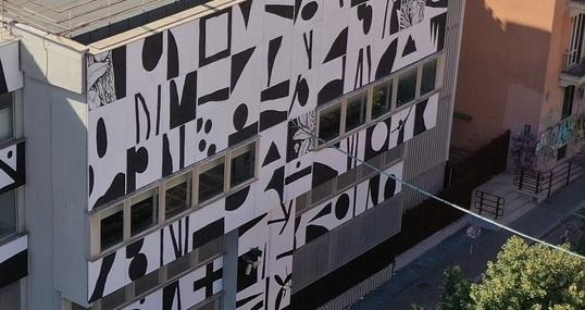 Il murales in via dei Marsi (foto dalla pagina Facebook della Sapienza)